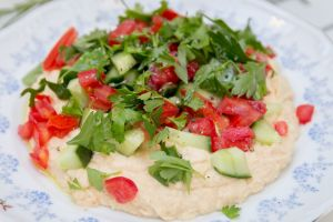 Hummus Topped With Tomato, Cucumber and Parsley